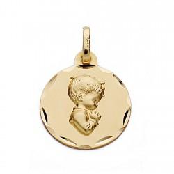 Medalla oro 18k chico comunión rezando 16mm. redonda cerco tallado