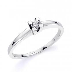 Solitario oro blanco 18k centro diamante brillante 0.100ct. liso garras