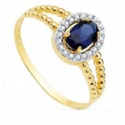Sortija oro bicolor 18k mujer centro piedra azul 6x4mm. cerco circonitas laterales bandas