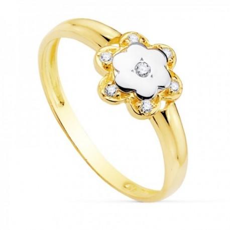Sortija oro bicolor 18k niña detalle flor 7mm. centro pétalos circonitas banda lisa